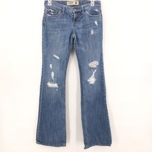 Pink bootcut distressed low rise jeans